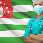 Surgeon with flag on background series - Abkhazia - stock photo