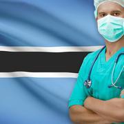 Surgeon with flag on background series - Botswana - stock photo