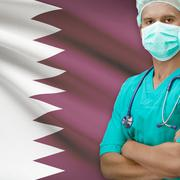 Surgeon with flag on background series - Qatar - stock photo