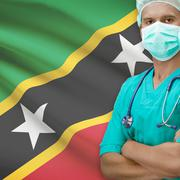 Surgeon with flag on background series - Saint Kitts and Nevis Stock Photos