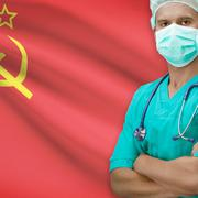 Surgeon with flag on background series - USSR - Soviet Union - stock photo