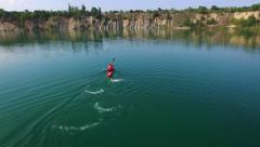 Aerial: athlete rowing in a kayak - stock footage