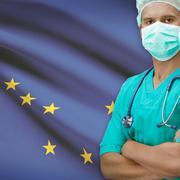 Surgeon with US states flags on background series - Alaska - stock photo