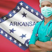 Surgeon with US states flags on background series - Arkansas - stock photo