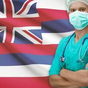 Surgeon with US states flags on background series - Hawaii Stock Photos