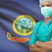 Stock Photo of Surgeon with US states flags on background series - Idaho