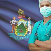 Surgeon with US states flags on background series - Maine - stock photo