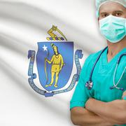 Stock Photo of Surgeon with US states flags on background series - Massachusetts
