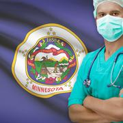 Stock Photo of Surgeon with US states flags on background series - Minnesota