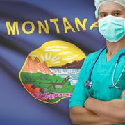 Surgeon with US states flags on background series - Montana - stock photo