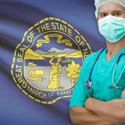 Surgeon with US states flags on background series - Nebraska - stock photo