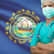 Surgeon with US states flags on background series - New Hampshire - stock photo