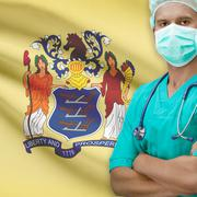 Surgeon with US states flags on background series - New Jersey - stock photo