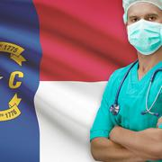 Surgeon with US states flags on background series - North Carolina - stock photo