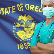 Surgeon with US states flags on background series - Oregon Stock Photos