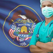 Surgeon with US states flags on background series - Utah Stock Photos