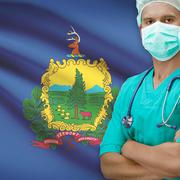 Surgeon with US states flags on background series - Vermont - stock photo