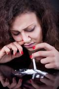 drug abuse, woman taking drugs, snorting cocaine portrait - stock photo