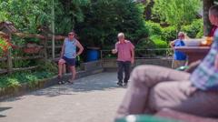 Group of senior men's boules outside Stock Footage