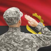 Soldier in hat facing national flag series - Angola - stock photo