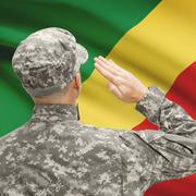 Soldier in hat facing national flag series - Congo-Brazzaville Stock Photos