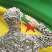 Soldier in hat facing national flag series - French Guiana - stock photo