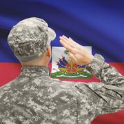 Soldier in hat facing national flag series - Haiti - stock photo