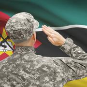 Stock Photo of Soldier in hat facing national flag series - Mozambique