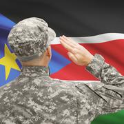 Soldier in hat facing national flag series - South Sudan Stock Photos