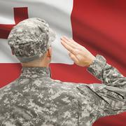 Soldier in hat facing national flag series - Tonga Stock Photos