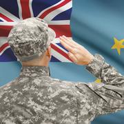 Soldier in hat facing national flag series - Tuvalu Stock Photos