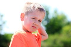 Unhappy child expression Stock Photos