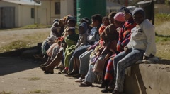 African mothers and children queuing at rural clinic Stock Footage