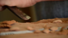 Luthier manufacturing a instrument with a chisel Stock Footage
