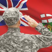 Soldier saluting to Canadial province flag series - Manitoba Stock Photos