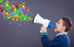 Child yells into a megaphone,splattered colors exiting from him Kuvituskuvat