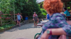 Senior player playing boule game Stock Footage