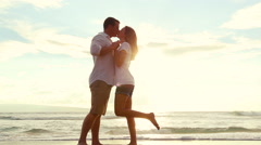 Passionate Couple Kissing in Love at Beach Sunset - stock footage