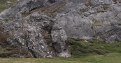 Pan of Scenic Grassy Rock Outcropping Stock Footage