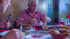 Old man cutting his food and eating it Stock Footage