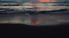 Beach Sunset in Hawaii. Steadicam Shot Panning Up Over Incoming Waves and Beauti Stock Footage