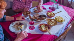 Senior couple is trying out different local foods on a table Stock Footage