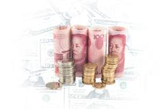 Chinese money on USD background Stock Photos