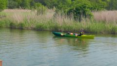 Family kayaking in nature. Healthy activity Stock Footage