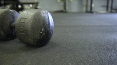 Large Dumbbell on Athletic Surface Stock Footage
