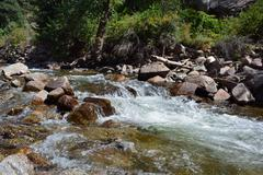 Whitewater Flows Over Rocks in the Mountains Stock Photos