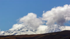 Stock Video Footage of Clouds forming over snow-capped Antisana Volcano Ecuador, time-lapse.