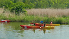 Families with children kayaking in nature. Healthy lifestyle Stock Footage