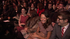 Spectators seated in first row at MAX AZRIA FASHION SHOW - stock footage