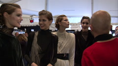 Fashion models preparing backstage for fashion show Stock Footage